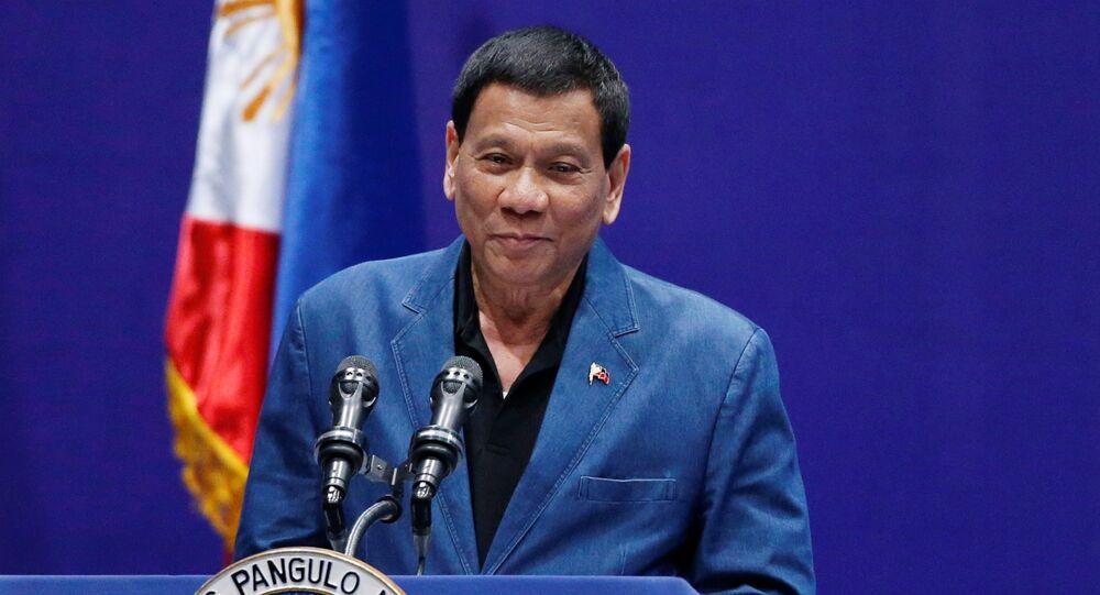 Philippine President Rodrigo Duterte addresses an event with Filipino community in Hong Kong, China April 12, 2018
