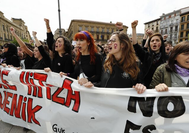 People shout slogans during a protest in Pamplona on April 28, 2018 after five men, accused of gang raping a woman at Pamplona's bull-running festival, were sentenced to nine years in jail for sexual abuse, avoiding the more serious charge of rape