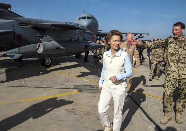 German Defence Minister Ursula von der Leyen, left, inspects a German air force aircraft as she visits the German contingent at the Al Azraq air base in Jordan. File photo
