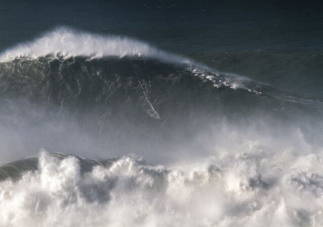 In this photo taken Nov. 8 2017, Brazilian surfer Rodrigo Koxa rides what has been judged the biggest wave ever surfed, at the Praia do Norte, or North beach, in Nazare, Portugal. On Saturday, April 28 2018, the World Surf League credited Koxa with a world record for riding the biggest wave ever surfed and said that its judging panel determined the wave was 80 feet (24.38 meters)