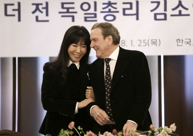 Former German Chancellor Gerhard Schroeder and his South Korean fiancee Kim So-yeon smile during a press conference in Seoul, South Korea, January 25, 2018