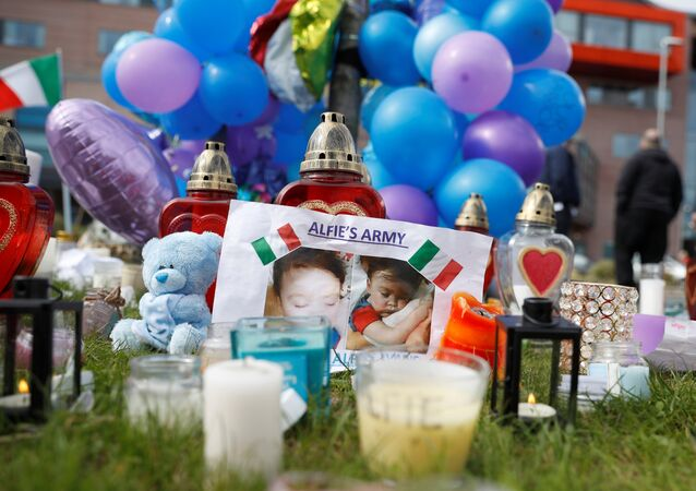 Flowers, candles and childrens' toys left as a memorial to Alfie Evans, the 23-month-old toddler who died a week after his life support was withdrawn, are seen outside Alder Hey Children's Hospital in Liverpool, Britain, April 28, 2018
