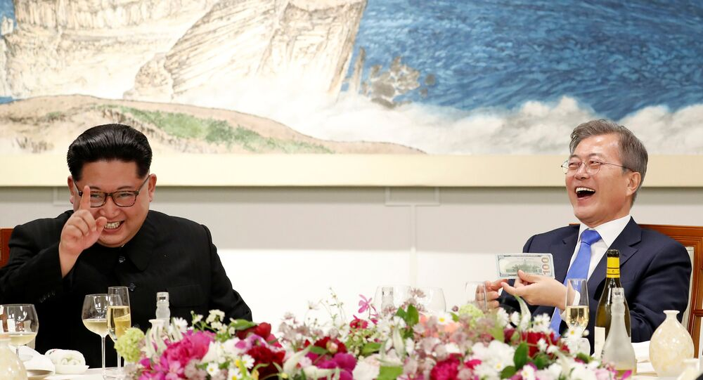 South Korean President Moon Jae-in and North Korean leader Kim Jong Un attend a banquet on the Peace House at the truce village of Panmunjom