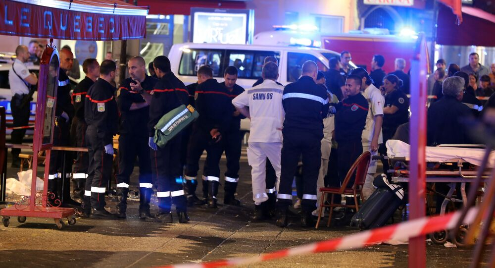 Police and firefighters stand at the scene of an incident in a street of Nice late April 30, 2018