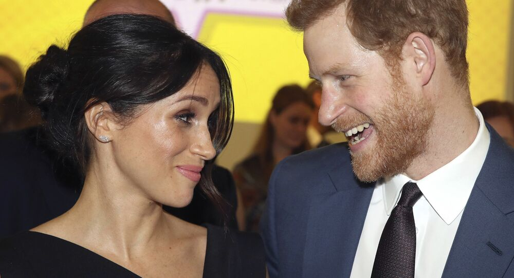 Britain's Prince Harry, left and Meghan Markle attend a women's empowerment reception at the Royal Aeronautical Society, during the Commonwealth Heads of Government Meeting, in London, Thursday April 19, 2018.