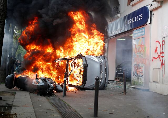 A car burns outside a Renault automobile garage during clashes during the May Day labour union march in Paris, France, May 1, 2018