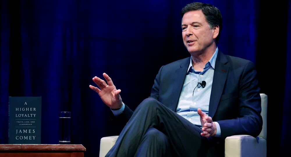 Former FBI director James Comey speaks about his book during an onstage interview with Axios Executive Editor Mike Allen at George Washington University in Washington, U.S. April 30, 2018
