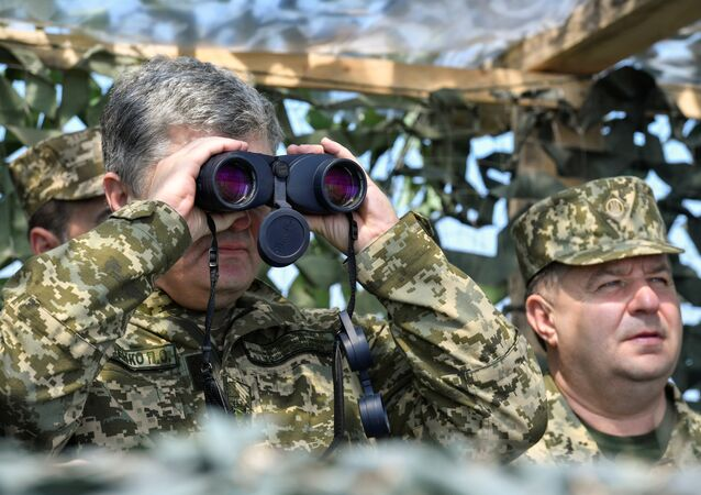Ukrainian President Petro Poroshenko uses a pair of binoculars while watching the final testing of the Vilkha missile complex in Kherson Region, Ukraine April 25, 2018
