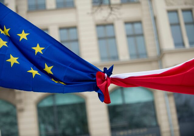 Knotted EU, left,  and Polish flags (File)