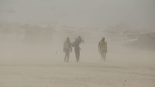 Indians walk on the banks of the river Ganges during a dust storm in Allahabad, India (File) - Sputnik International