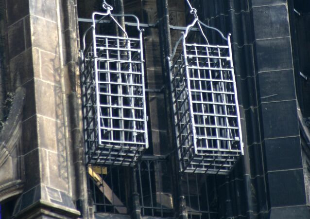 Iron baskets that held the corpses of the leaders of the Münster Rebellion at the steeple of St. Lambert's Church