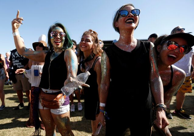 Concertgoers dance during a performance by Nile Rodgers at the Coachella Valley Music and Arts Festival in Indio, California, U.S., April 14, 2018