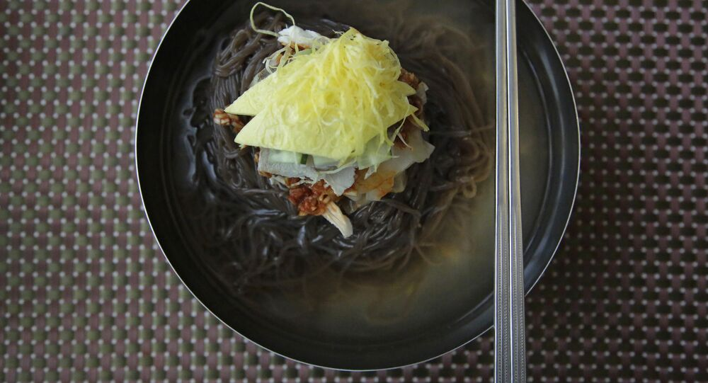 In this Friday, June 16, 2017, photo, a bowl of Naengmyeon or cold buckwheat noodles, popular among North Koreans, is served in a restaurant in Pyongyang, North Korea