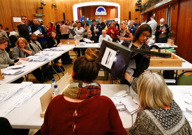 Volunteers count ballot papers at Wandsworth Town Hall after local government elections in London, Britain, May 3, 2018