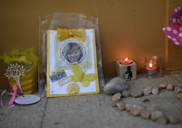 Picture shows candles and a photograph of Maddie, placed on the street as a tribute to Madeleine McCann, outside the church in Praia da Luz near Lagos on May 3, 2017