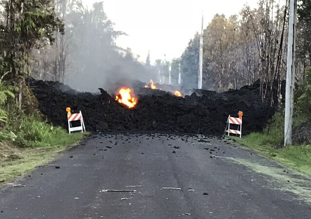 This photo provided by Hawaii Electric Light shows Mohala Street in Leiliani Estates near the town of Pahoa on Hawaii's Big Island that is blocked by a lava flow from the eruption of Kilauea volcano.