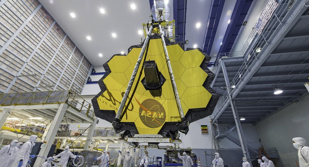 In this April 13, 2017 photo provided by NASA, technicians lift the mirror of the James Webb Space Telescope using a crane at the Goddard Space Flight Center in Greenbelt, Md.
