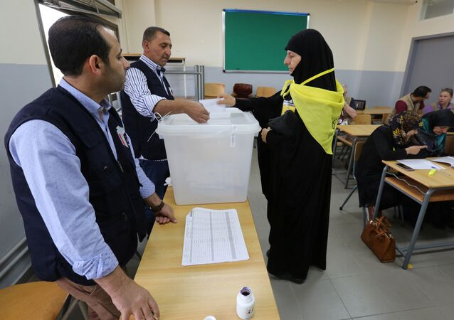 A woman supporter of Hezbollah casts her vote at a polling station during the parliamentary election in Tibnin, South Lebanon, May 6, 2018