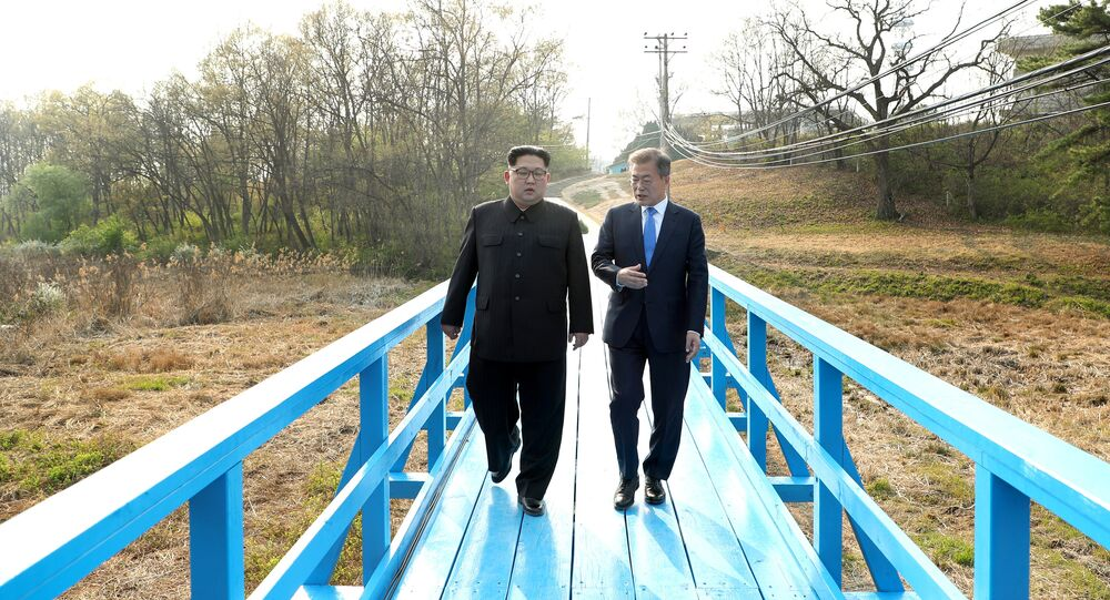South Korean President Moon Jae-in and North Korean leader Kim Jong Un walk together at the truce village of Panmunjom inside the demilitarized zone separating the two Koreas, South Korea, April 27, 2018