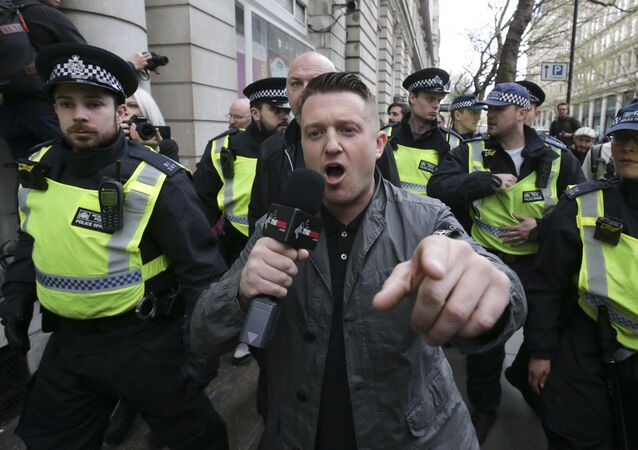 (File) Stephen Christopher Yaxley-Lennon, AKA Tommy Robinson, former leader of the right-wing EDL (English Defence League) is escorted away by police from a Britain First march and an English Defence League march in central London on April 4, 2017