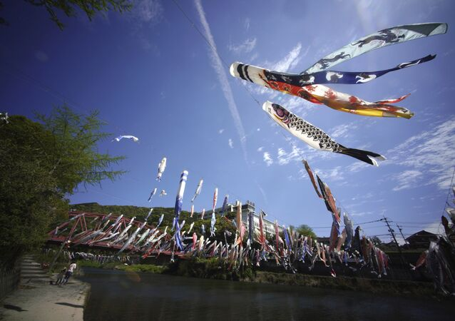 Colorful carp streamers flutter in the air over the Kawakami Gorge in Saga, Saga prefecture, southwestern Japan, Friday, April 13, 2018. The colorful streamers are hung to mark Children's Day on May 5, wishing children's healthy growth like carp that can swim up a waterfall