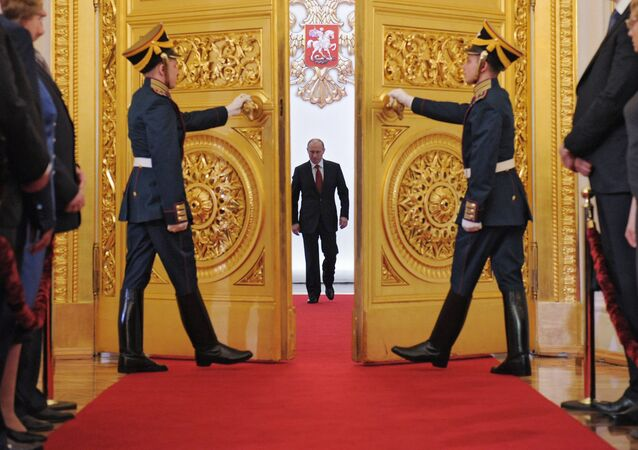 President-elect Vladimir Putin, center, enters St Andrew Hall of the Grand Kremlin Palace during the inauguration ceremony. File photo