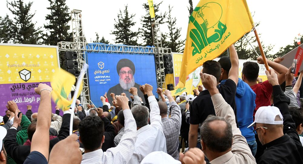 Hezbollah leader Sayyed Hassan Nasrallah is seen on a screen during election rallies a few days before the general election in Baalbeck, Lebanon, May 1, 2018