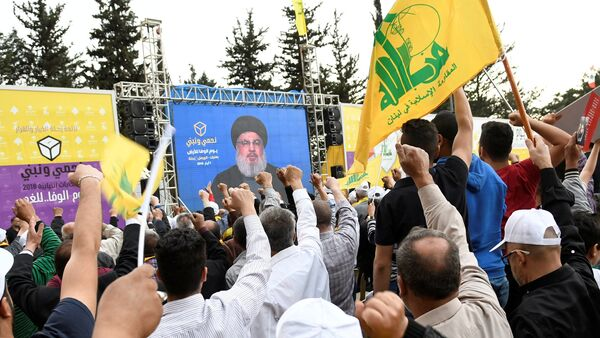 Hezbollah leader Sayyed Hassan Nasrallah is seen on a screen during election rallies a few days before the general election in Baalbeck, Lebanon, May 1, 2018 - Sputnik International