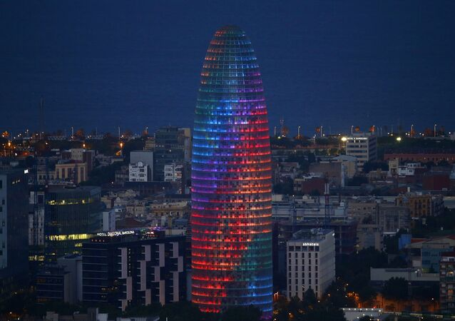 The Agbar tower is illuminated with gay pride rainbow during World Pride in Barcelona, Spain, Wednesday, June 28, 2017