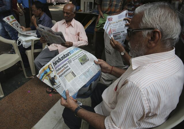 Indians read news about seven Indian Engineers abducted in Afghanistan in a newspapers, in Mumbai, India, Monday, May 7, 2018