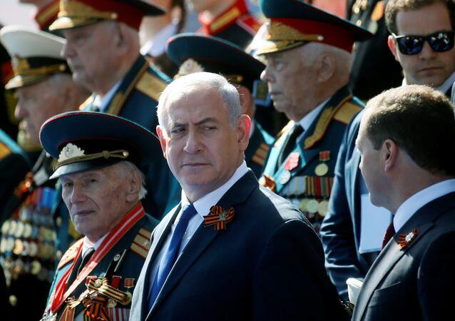 Israeli Prime Minister Benjamin Netanyahu and his Russian counterpart Dmitry Medvedev attend the Victory Day parade, marking the 73rd anniversary of the victory over Nazi Germany in World War Two, at Red Square in Moscow, Russia May 9, 2018