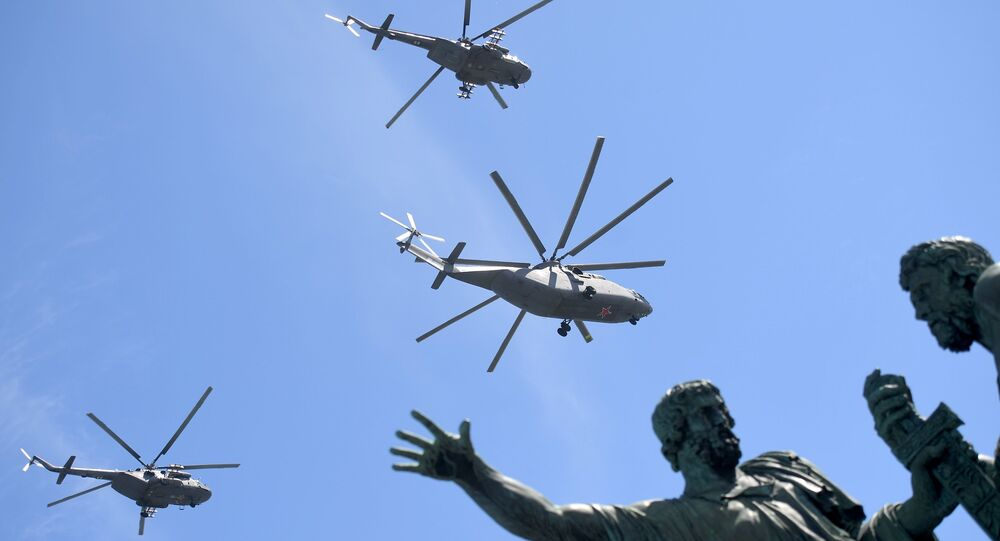 The heavy transport Mi-26 helicopter and the multi-purpose Mi-8AMTSh helicopters on the military parade devoted to the 73rd anniversary of the victory in the Great Patriotic War of 1941-1945