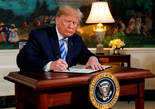 U.S. President Donald Trump signs a proclamation declaring his intention to withdraw from the JCPOA Iran nuclear agreement in the Diplomatic Room at the White House in Washington, U.S., May 8, 2018