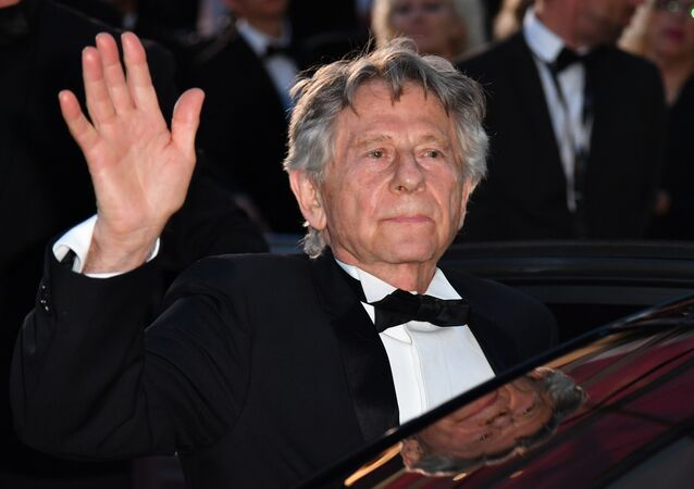 French-Polish director Roman Polanski waves as he leaves on May 27, 2017 following the screening of the film 'Based on a True Story' (D'Apres une Histoire Vraie) at the 70th edition of the Cannes Film Festival in Cannes, southern France