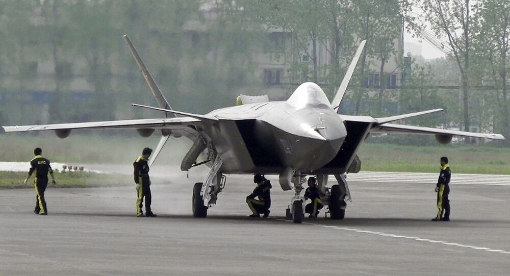 Chinese ground crew members inspect a J-20 stealth fighter in Chengdu, in southwest China's Sichuan province (File)