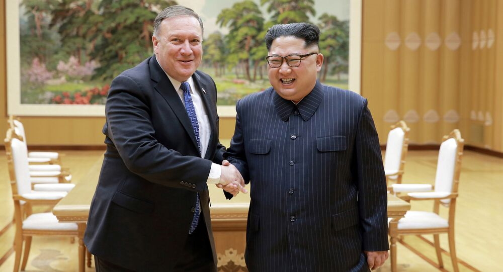 North Korean leader Kim Jong Un shakes hands with U.S. Secretary of State Mike Pompeo in this undated photo released on May 9, 2018 by North Korea's Korean Central News Agency (KCNA) in Pyongyang