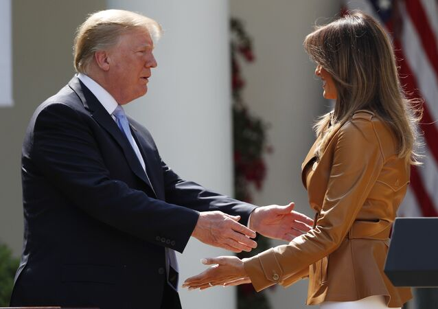 U.S. first lady Melania Trump is greeted by President Donald Trump during the launch of the first lady's Be Best initiatives in the Rose Garden of the White House in Washington, U.S., May 7, 2018