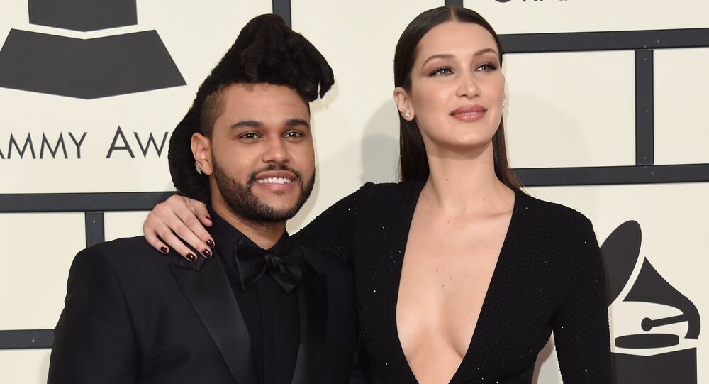 Bella Hadid and singer The Weeknd arrive on the red carpet for the 58th Annual Grammy music Awards in Los Angeles February 15, 2016