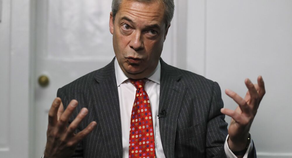 Former UK Independence Party (UKIP) leader Nigel Farage gestures during an interview with The Associated Press in London, Tuesday, Nov. 29, 2016.