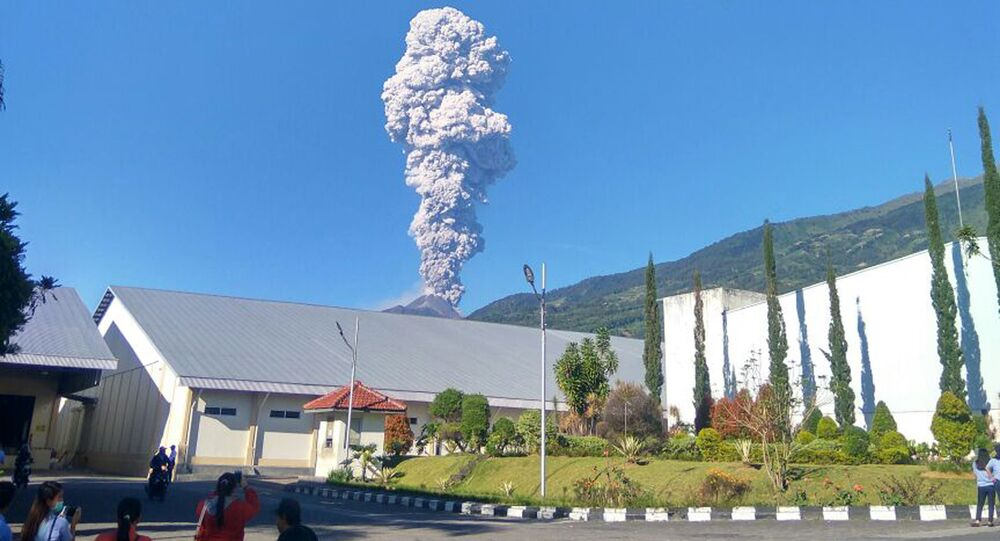 Mount Merapi spews volcanic materials from its crater as seen from Klaten, Central Java, Indonesia, Friday, May 11, 2018