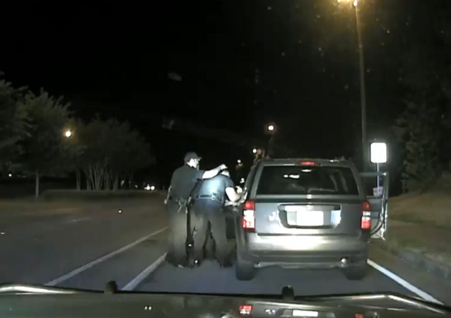 Dashcam footage shows officer with Georgia's Alpharetta Police Department use forceful behavior during arrest of 65-year-old grandmother