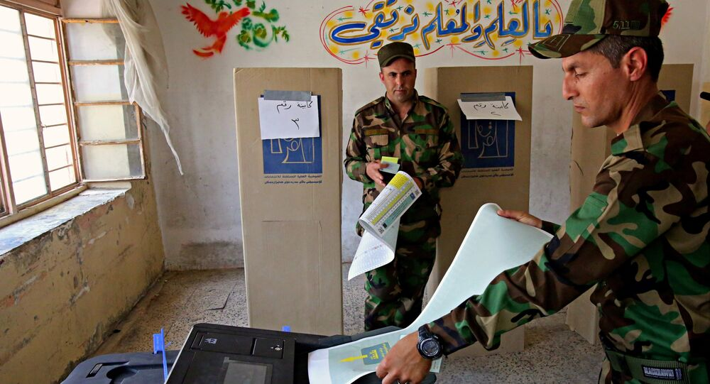 Iraqi soldiers prepare to cast their votes in early voting for Iraq's security forces, prisoners and hospital patients ahead of Saturday's national parliamentary elections, in Baghdad, Iraq, Thursday, May 10, 2018.