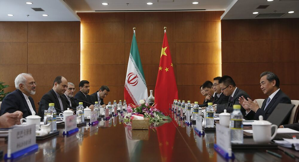 Chinese Foreign Minister Wang Yi, right, and Iranian Foreign Minister Mohammad Javad Zarif, left, attend a bilateral meeting Tuesday, Sept. 15, 2015 in Beijing, China