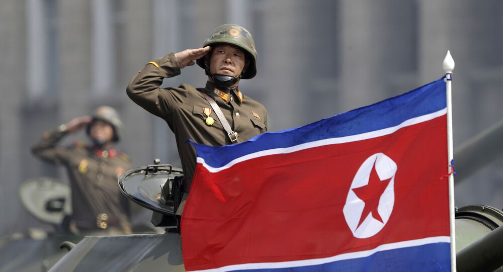 In this Saturday, April 15, 2017, file photo, a North Korean national flag flutters as soldiers in tanks salute to North Korean leader Kim Jong Un during a military parade in Pyongyang, North Korea to celebrate the 105th birth anniversary of Kim Il Sung, the country's late founder and grandfather of the current ruler