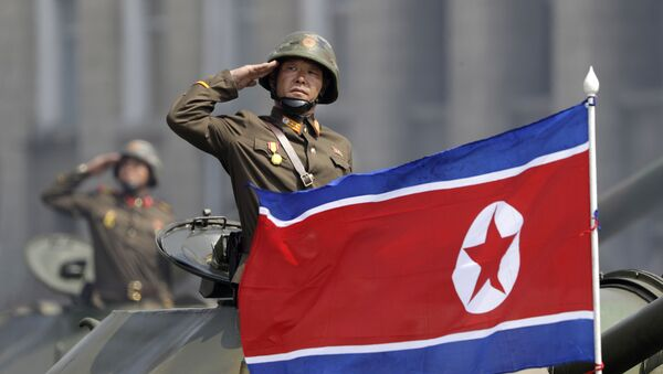 In this Saturday, April 15, 2017, file photo, a North Korean national flag flutters as soldiers in tanks salute to North Korean leader Kim Jong Un during a military parade in Pyongyang, North Korea to celebrate the 105th birth anniversary of Kim Il Sung, the country's late founder and grandfather of the current ruler - Sputnik International