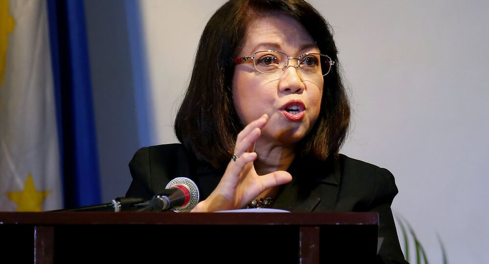 Embattled Philippine Supreme Court Chief Justice Maria Lourdes Sereno addresses students of St. Scholastica's College, a Roman Catholic school, during a forum on International Women's Day in Manila, Philippines. Wednesday, March 7, 2018. Sereno, who filed an indefinite leave starting March 1 to prepare for her impending impeachment trial, called on Filipinos Wednesday to stand up against authoritarianism and threats to human rights in an indirect criticism of the country's volatile leader, who has long called for her removal.