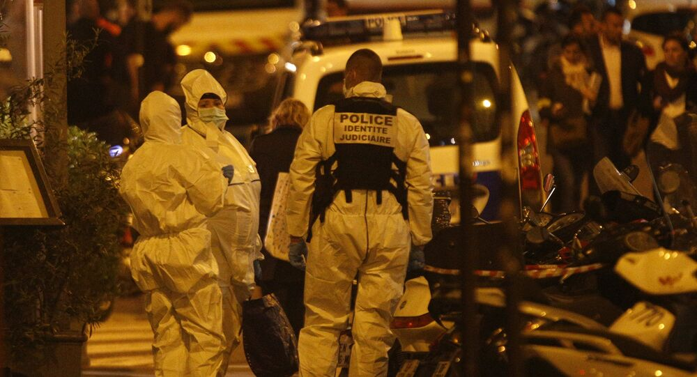 Forensic officers get ready as they arrive to inspect the area in Monsigny street in Paris centre after one person was killed and several injured by a man armed with a knife, who was shot dead by police in Paris on May 12, 2018