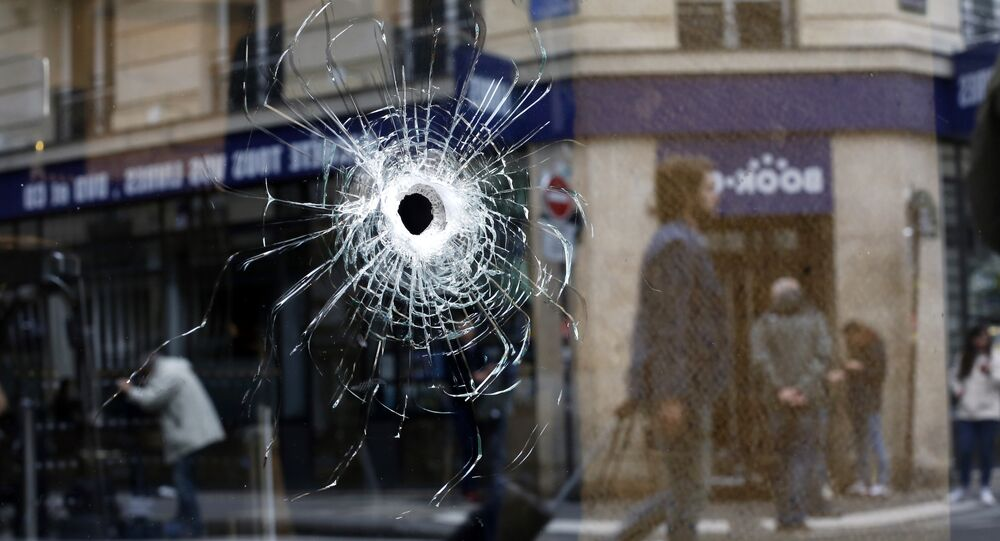 A bullet hole seen on the window of a cafe located near the area where the assailant of a knife attack was shot dead by police officers, in central Paris, Sunday May 13, 2018