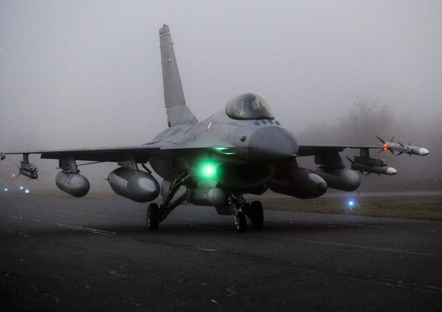 An F16 aircraft fighter is ready to take off from the Danish military base Fighter Wing Skrydstryp in Jutland early March 19, 2011