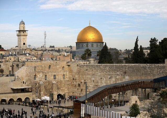 A general view of Jerusalem's Old City shows the Western Wall, Judaism's holiest prayer site, in the foreground as the Dome of the Rock, located on the compound known to Muslims as Noble Sanctuary and to Jews as Temple Mount, is seen in the background December 10, 2017